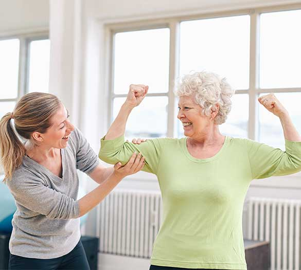 seniors smile while doing physical therapy