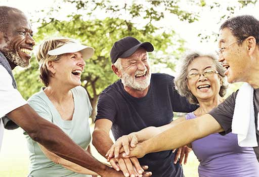 older adults smile after a group physical therapy class